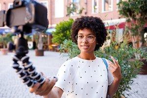 Female vlogger recording video