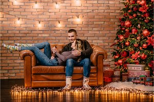 loving couple cuddling on couch at