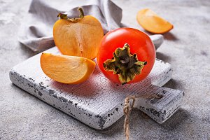 Fresh ripe persimmon on white