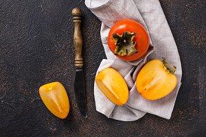 Fresh ripe persimmon on cutting