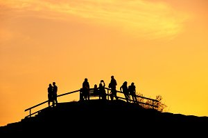 Silhouettes group people sunset park