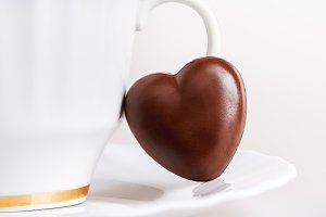 White cup, heart chocolate candy