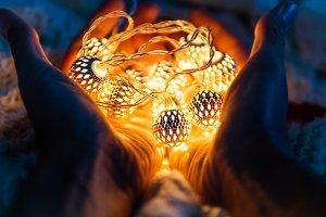 Hands full of light bulbs