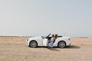 Girl Sitting in Modern Sport Car