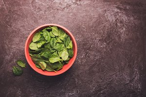 Washed fresh mini spinach in a bowl