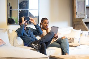 Young woman and man enjoying virtual