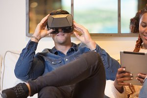 Young man enjoys virtual reality gla