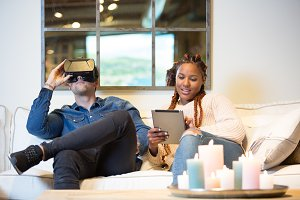 Young man and woman enjoying virtual