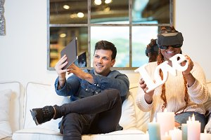 Young couple enjoying virtual realit
