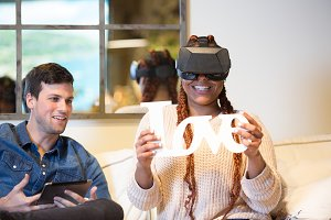 Young couple enjoy virtual reality g