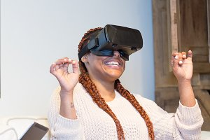 Happy young woman enjoying virtual r