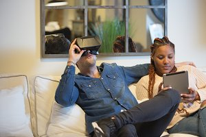 Happy young couple enjoying virtual