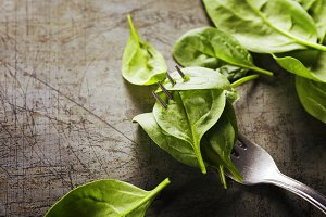 Spinach leaves on a fork