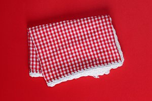 folded red cotton kitchen towel
