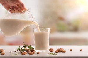 Serving glass of almond milk