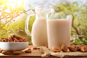 Almond drink and jug in nature