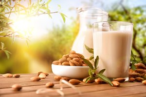 Almond drink on table nature front