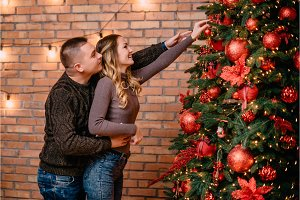 young couple decorating christmas