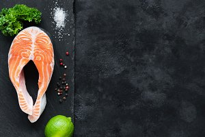 Salmon steak with lime on slate