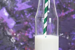 transparent glass bottle with milk