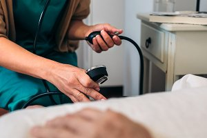 Caregiver checking blood pressure to