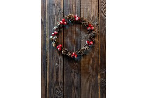 Christmas wreath on a rustic wooden