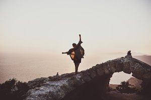 Woman balancing on stones in