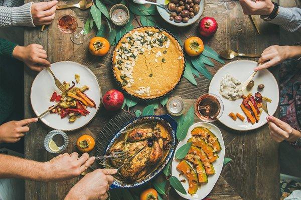 Friends feasting at Thanksgiving Da…