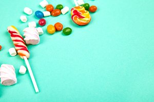 Colorful candies on pastel turquoise