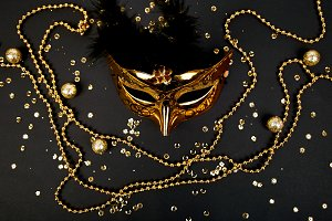 Black and gold carnival mask. Top