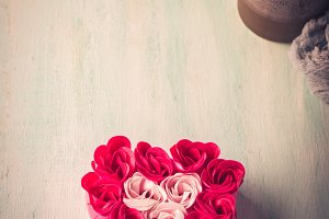 Heart shaped pink red roses on