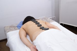 A woman in a clinic receiving hot
