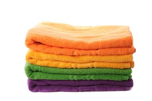 Stack of colorfull towels and yellow