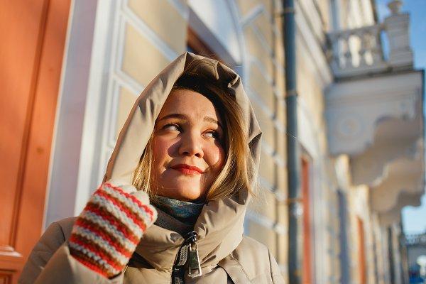 Cheerful stylish girl enjoying