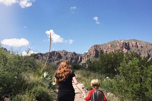 Woman and Son on a Trail