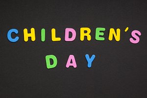 Children's day writing on black pape