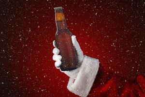 Santa Holding a Bottle of Beer Snow