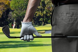 Closeup of a male golfer on a golf c