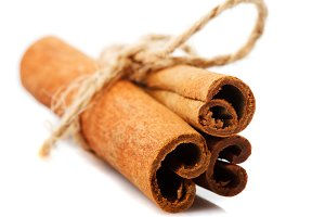 Cinnamon sticks close up isolated on