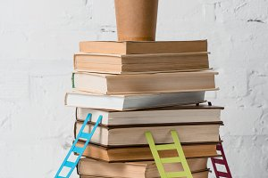 pile of books on table
