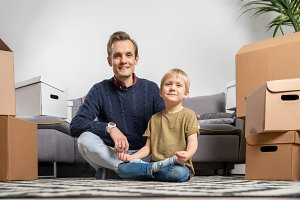 Image of father and boy sitting on