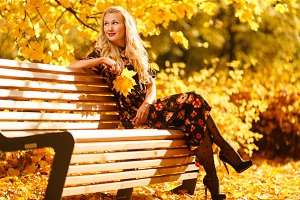 Image of blonde sitting on wooden