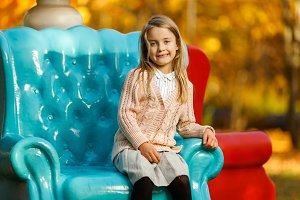 Image of girl sitting on blue chair
