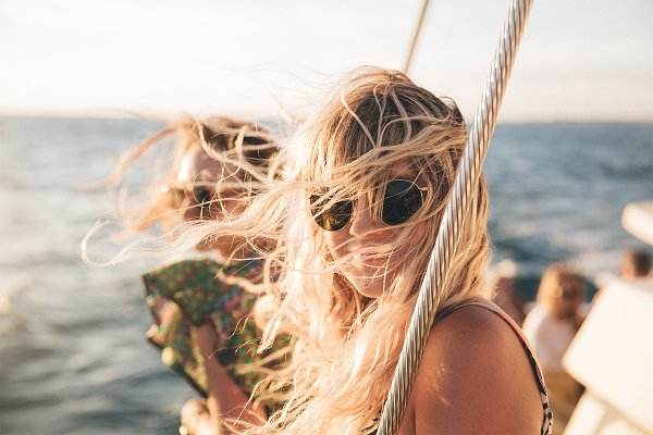 People Stock Photos: remi + tori - Wind blowing through hair on boat
