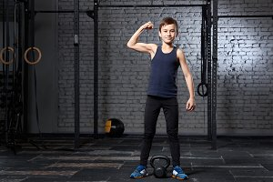 Training and sport. Kid in crossfit