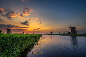 Sunset above historic windmills in