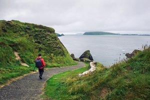 Young man walks along pathway