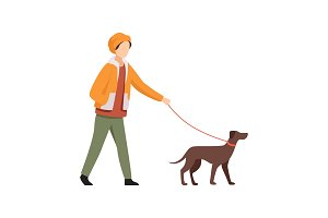 Young man walking with dog in