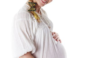 Pregnant woman smiling isolated on w
