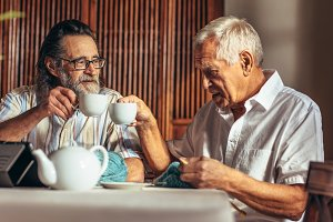 Retired friends having tea